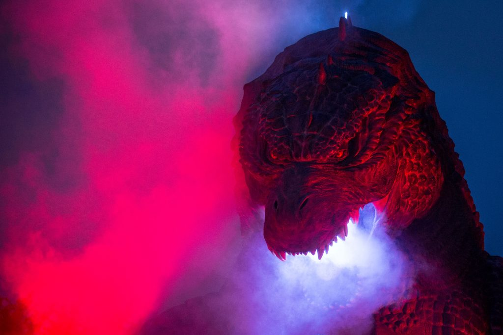 A 6.6 meter replica Godzilla is lit up during a press preview at Tokyo Midtown on July 17, 2014 in Tokyo, Japan
