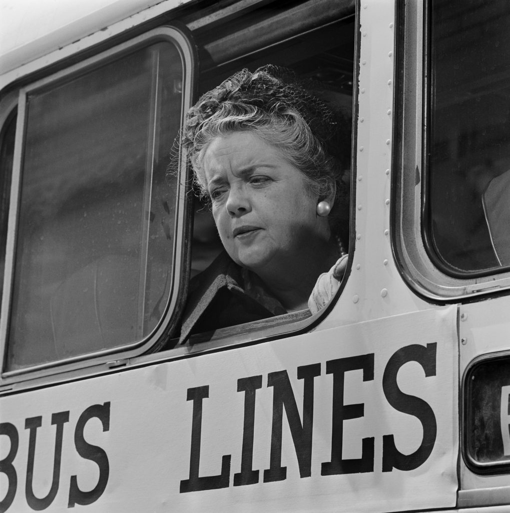 Frances Bavier as Aunt Bee looks out a bus window on 'The Andy Griffith Show'