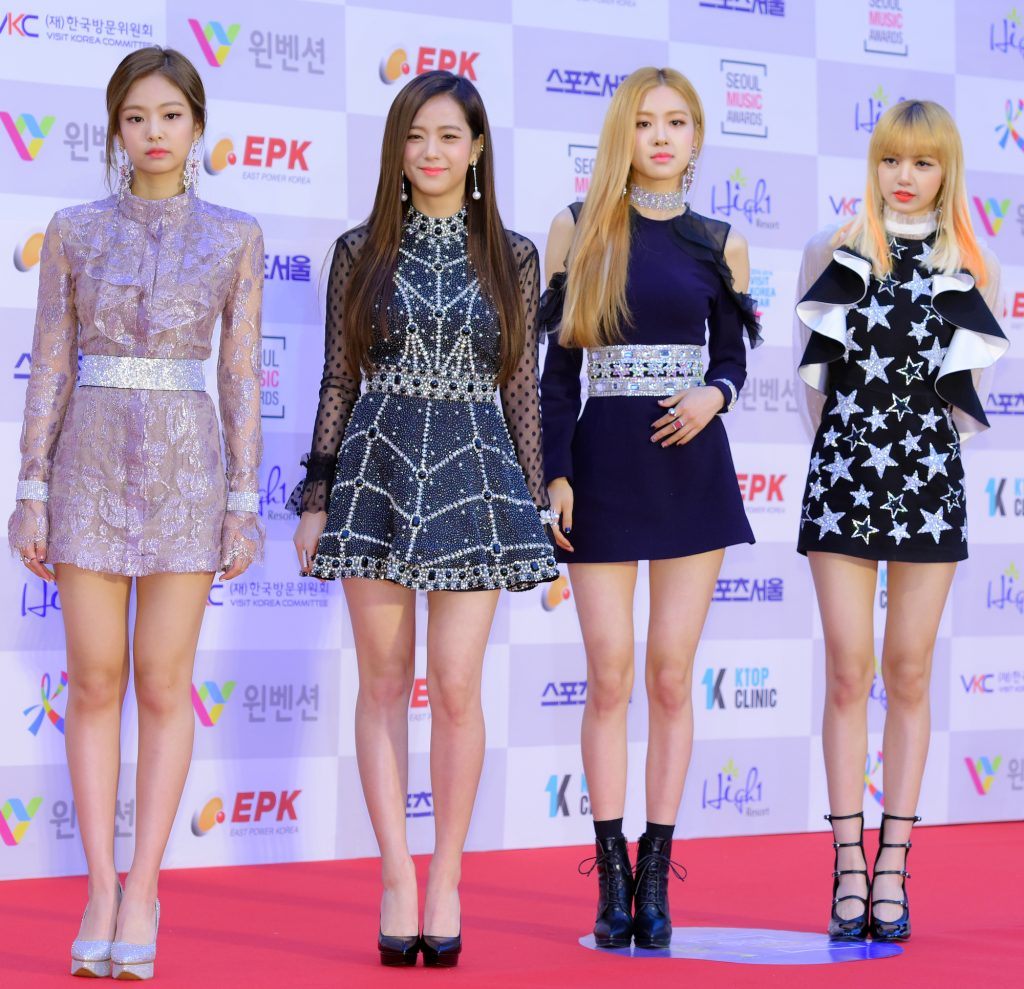 BLACKPINK in front of a step and repeat