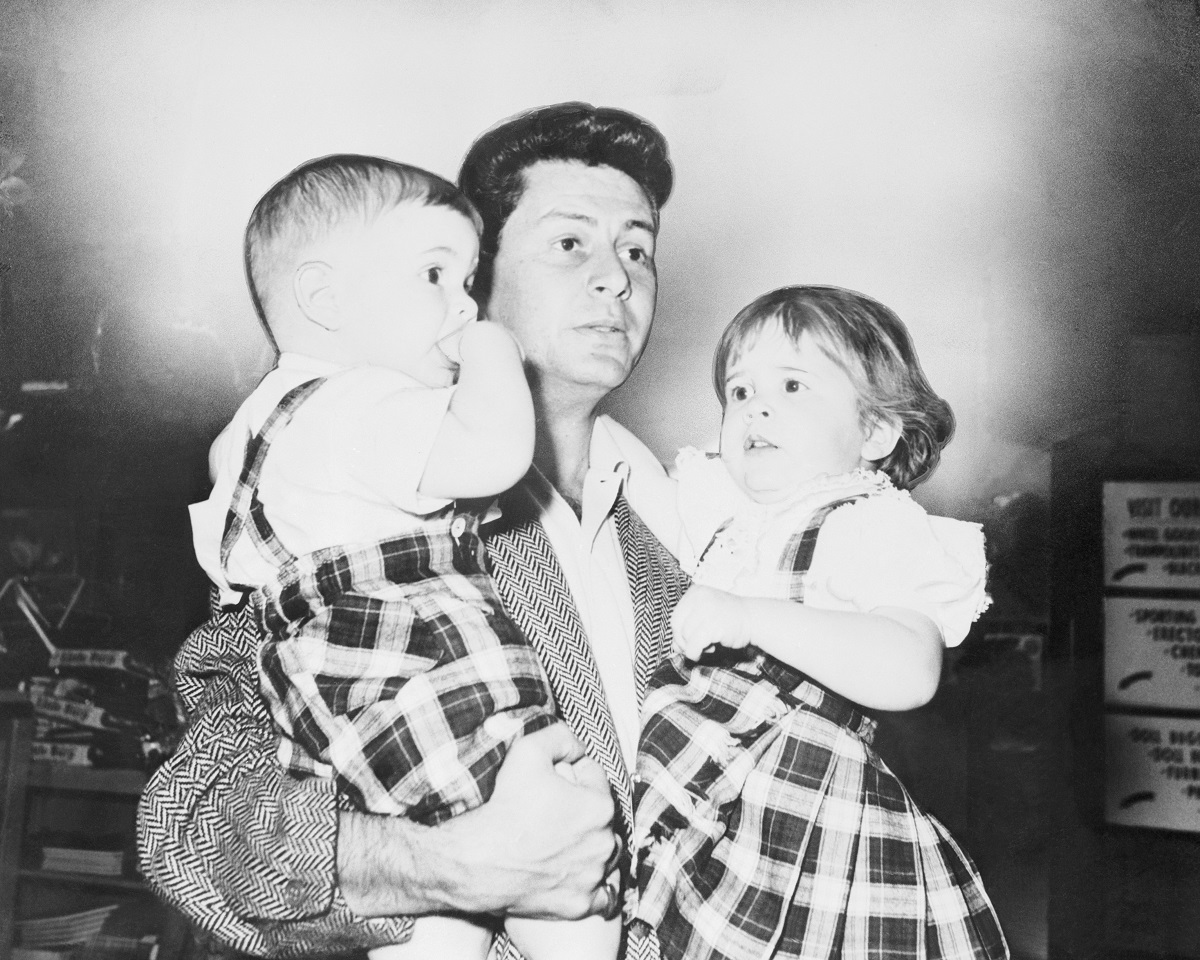 Eddie Fisher holds his two children, Todd 1, and Carrie, 2, (R), in March 1959.
