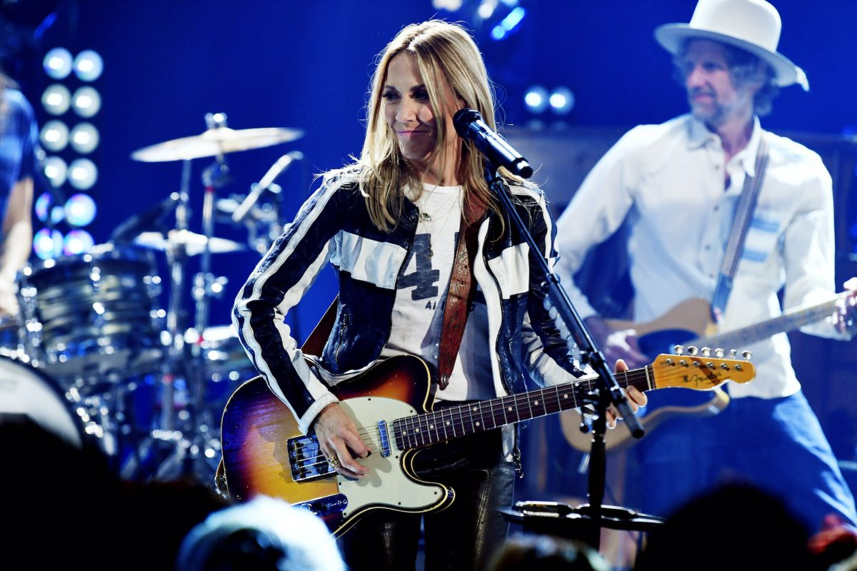 Sheryl Crow performs live onstage with her guitar