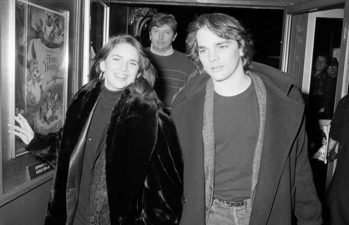 Melissa Gilbert and Bo Brinkman walk down a hallway in black and white