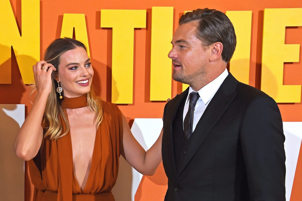 Margot Robbie puts her hand on Leonardo DiCaprio's shoulder at the UK Premiere of 'Once Upon a Time...In Hollywood'