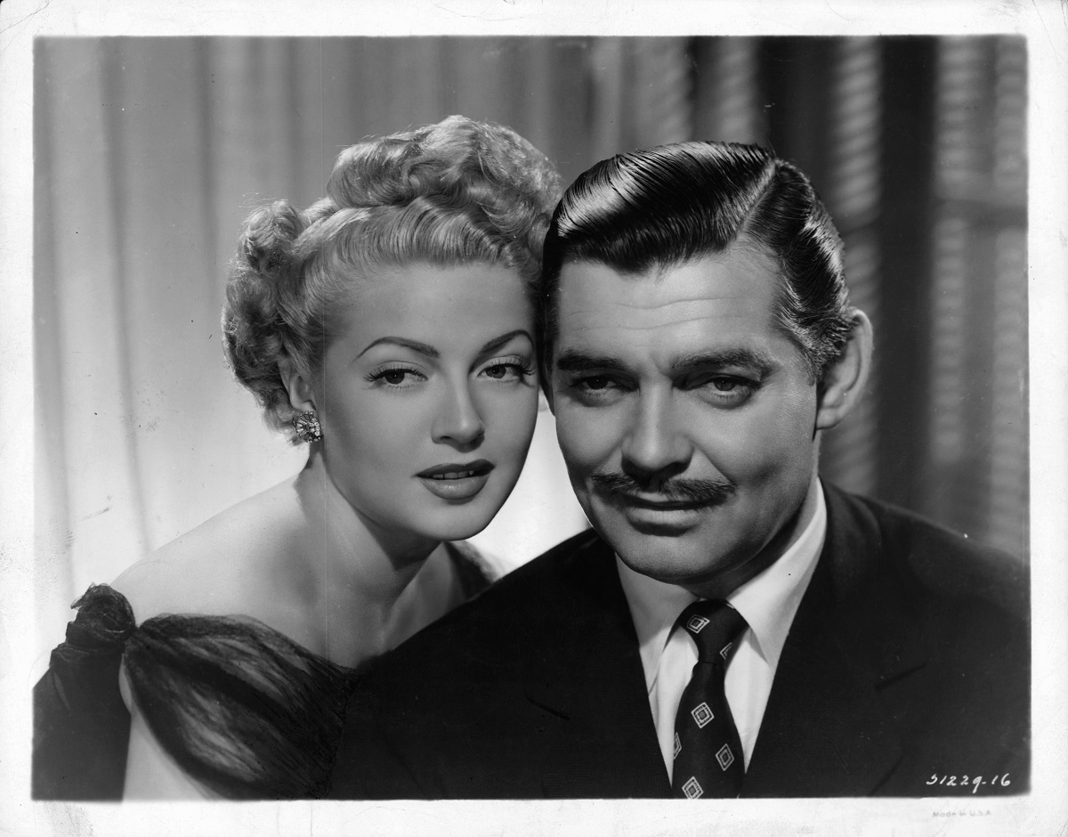 Lana Turner (L) leaning into Clark Gable (R) in a scene from the film 'Somewhere I'll Find You', 1942.