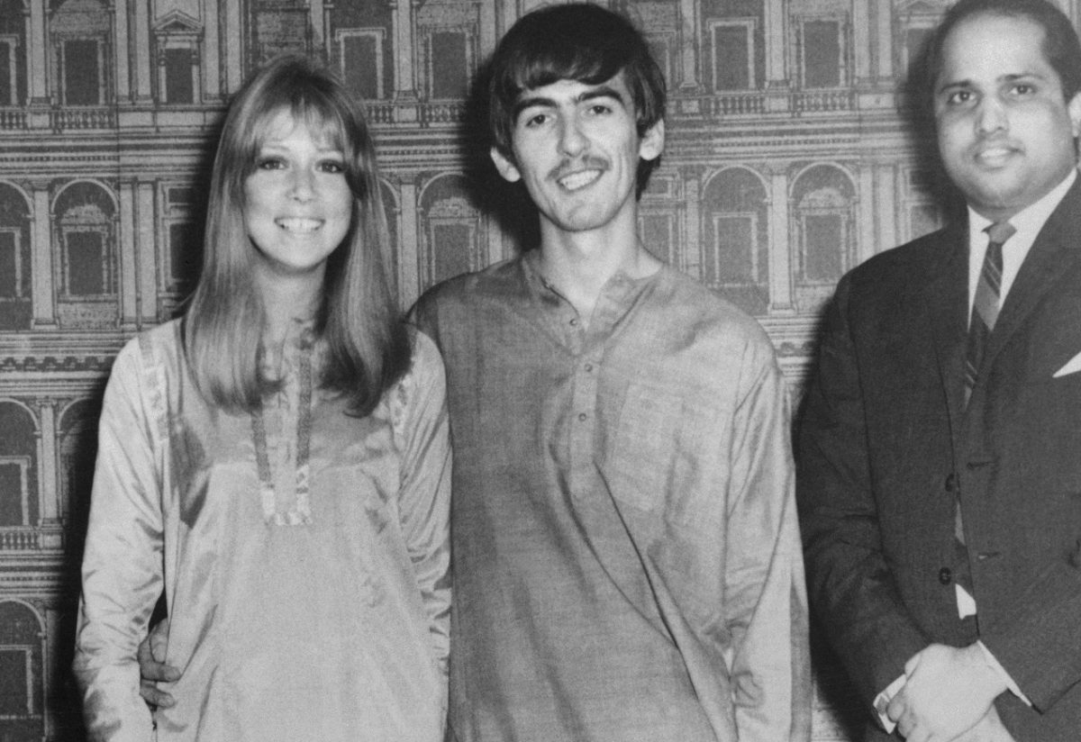 George Harrison and his wife Pattie Harrison posing for the camera in India, 1966