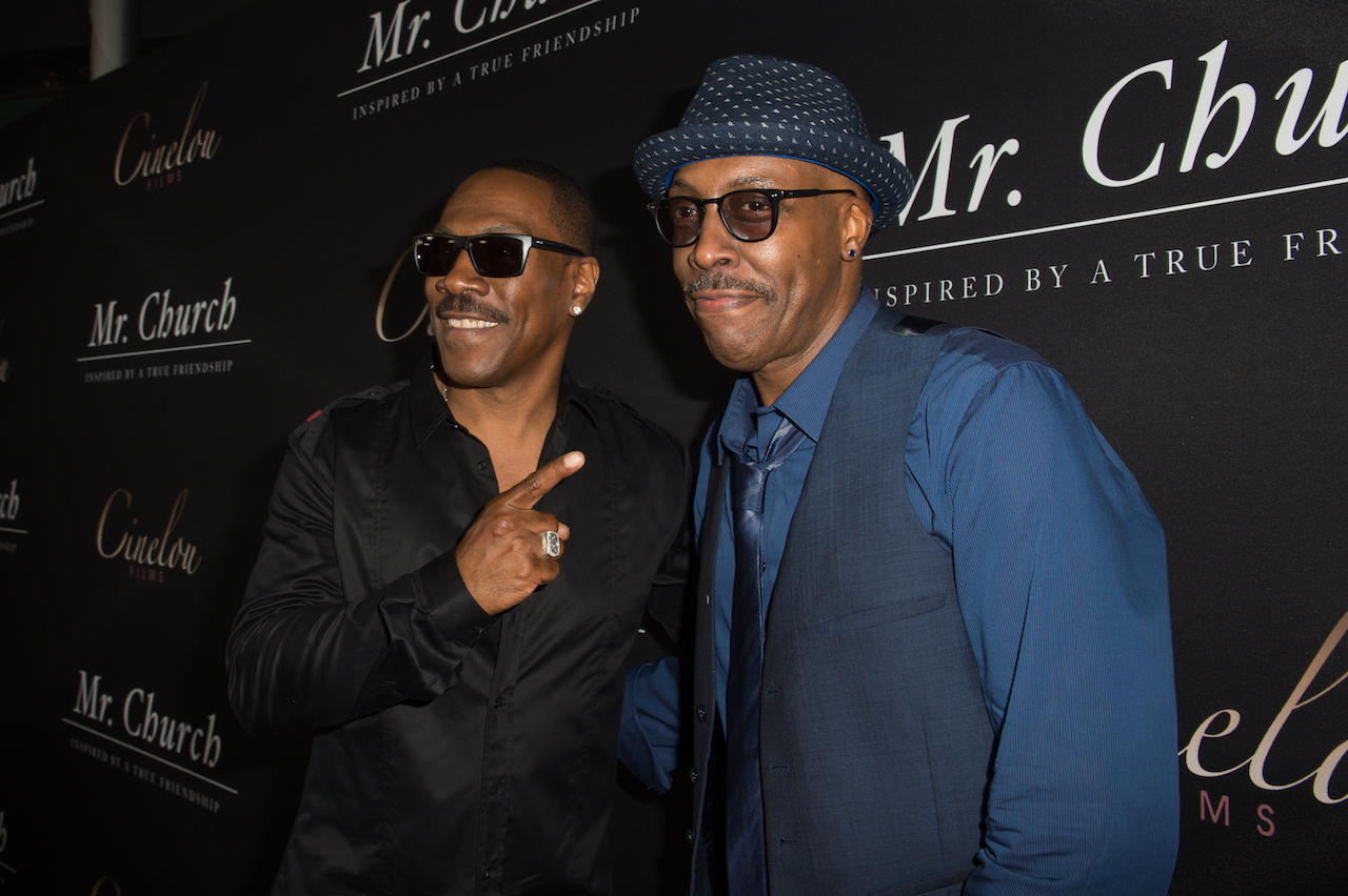 Eddie Murphy (L) and actor/comedian Arsenio Hall attend the premiere of Cinelou Releasing's 'Mr. Church'