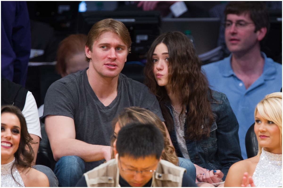 Tyler Jacob Moore and Emmy Rossum attend event.