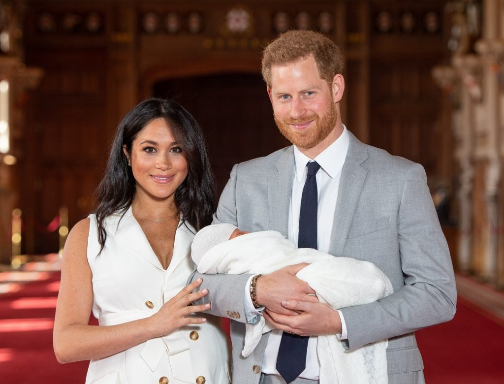 Prince Harry and Meghan Markle pose with their son, Archie Harrison Mountbatten-Windsor, during a photocall two days after he was born