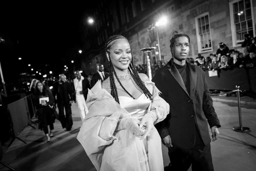 A black and white photo of Rihanna arriving at the Fashion Awards 2019 with A$AP Rocky