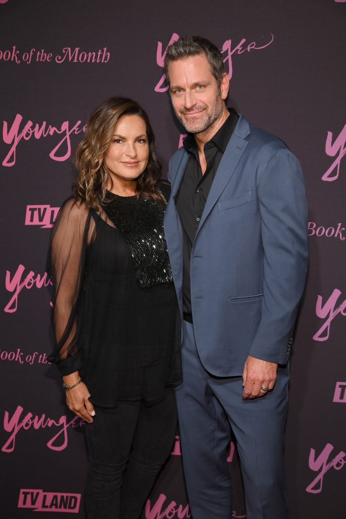 Mariska Hargitay and Peter Hermann pose for photo together on the carpet at Younger Season 6 premiere