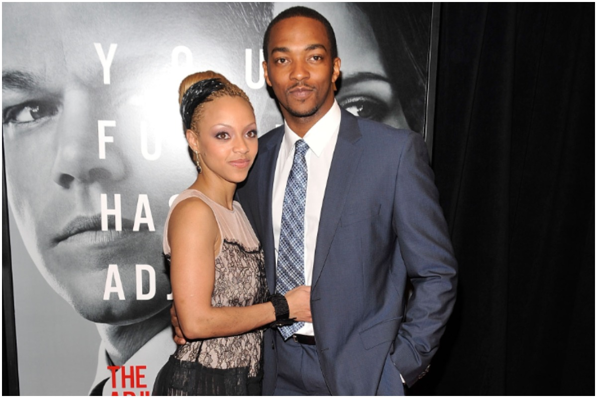 'The Falcon and the Winter Soldier' star Anthony Mackie wearing a blue suit and tie while embracing his ex-wife, Sheletta Capital. Capital is smiling while wearing a tan and black dress.