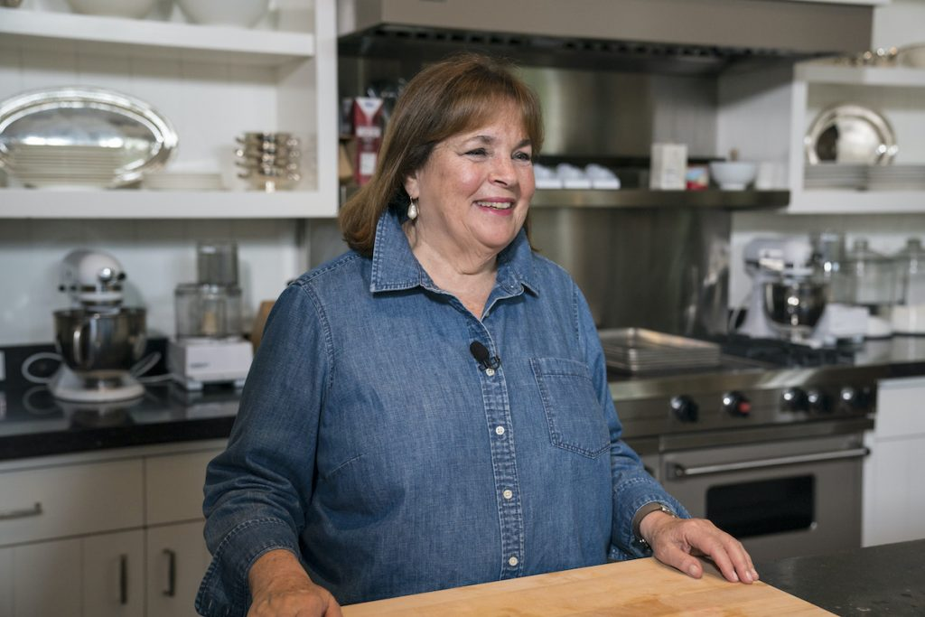 """Ina Garten smiles as she stands in front of the counter inside the """"barn"""" on her property in East Hampton, New York."""