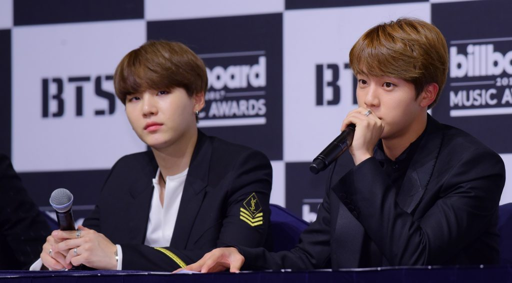 Suga and Jin of BTS at a press conference for the 2017 Billboard Music Awards