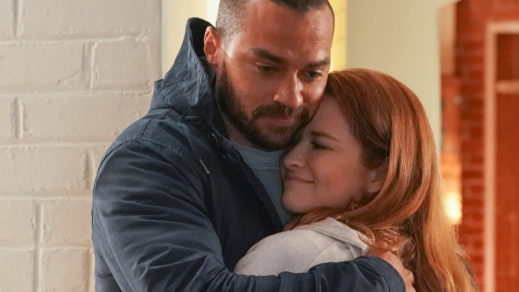 Jesse Williams as Jackson Avery and Sarah Drew as April Kepner hugging each other in 'Grey's Anatomy' Season 17 Episode 14, 'Look Up Child'