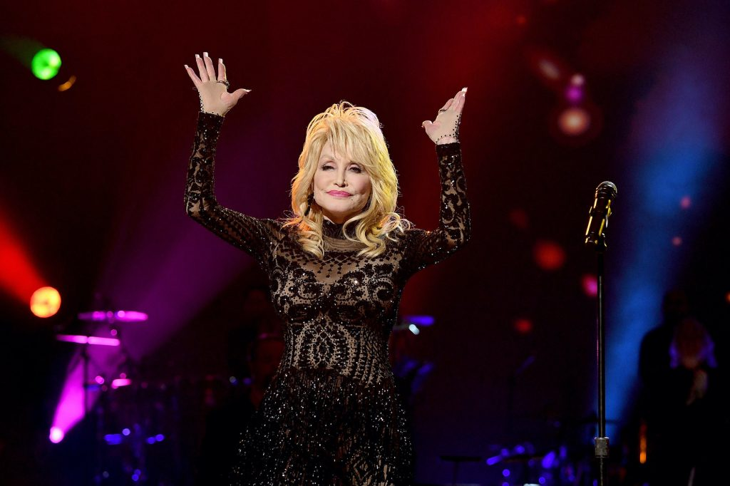 Dolly Parton smiling on stage