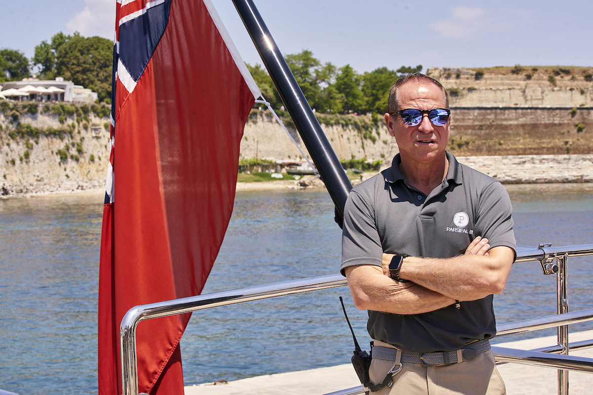 Captain Glenn Shephard waits for guests on Below Deck Sailing Yacht