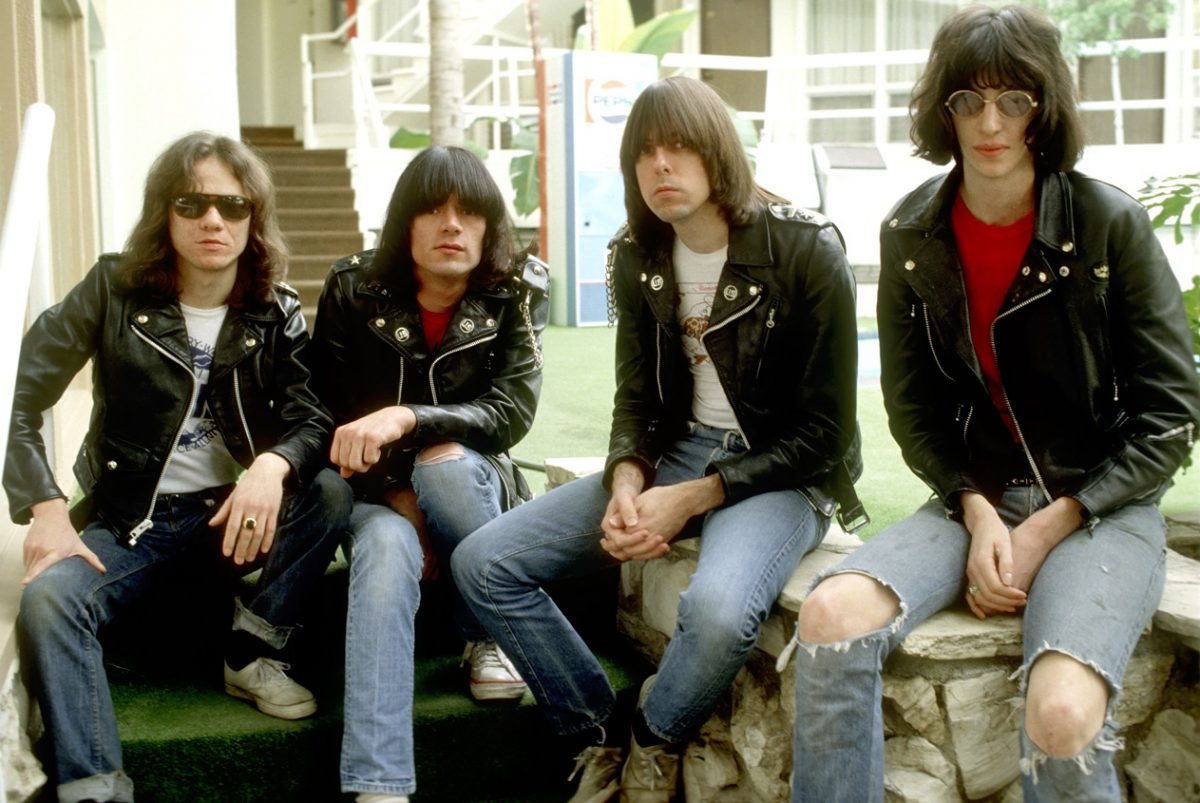 Band photo of the Ramones, seated outdoors