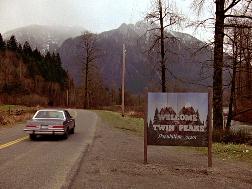 'Twin Peaks' welcome sign in front of a giant mountain