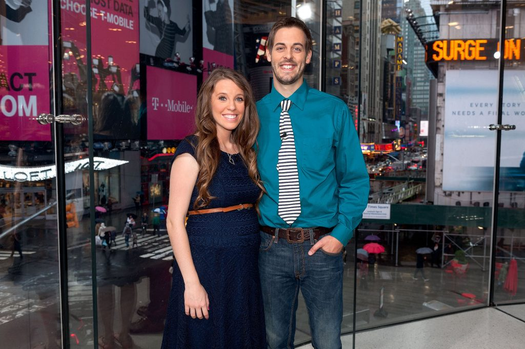 Jill Duggar of the Duggar family and Derick Dillard from TLC's 'Counting On' standing on the set of 'Extra' smiling at the camera