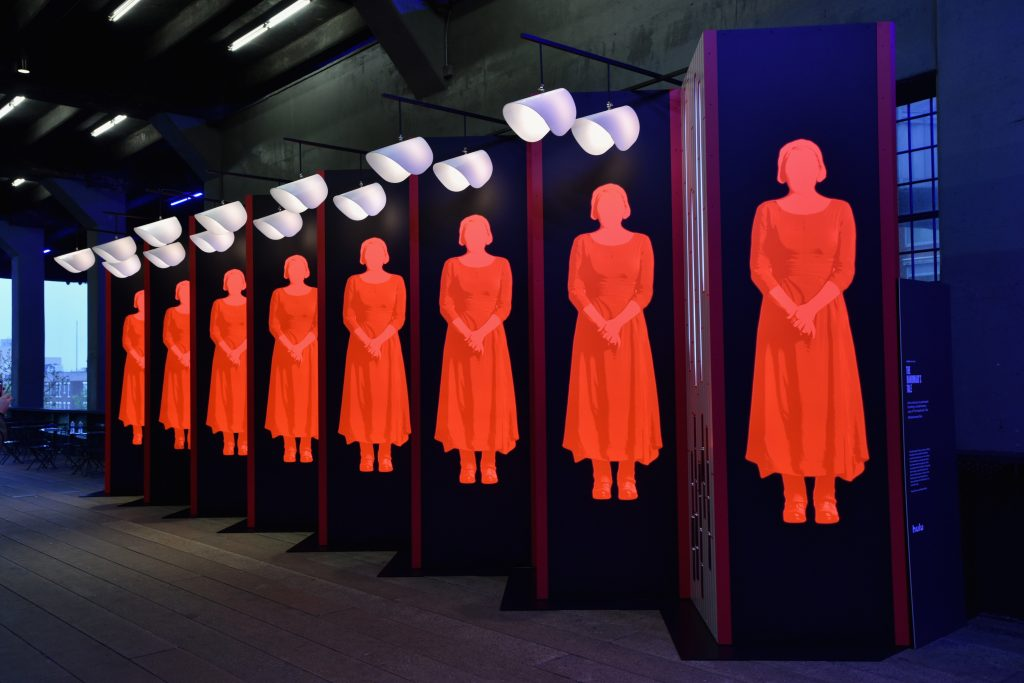 Art inspired by The Handmaid's Tale depicting handmaids