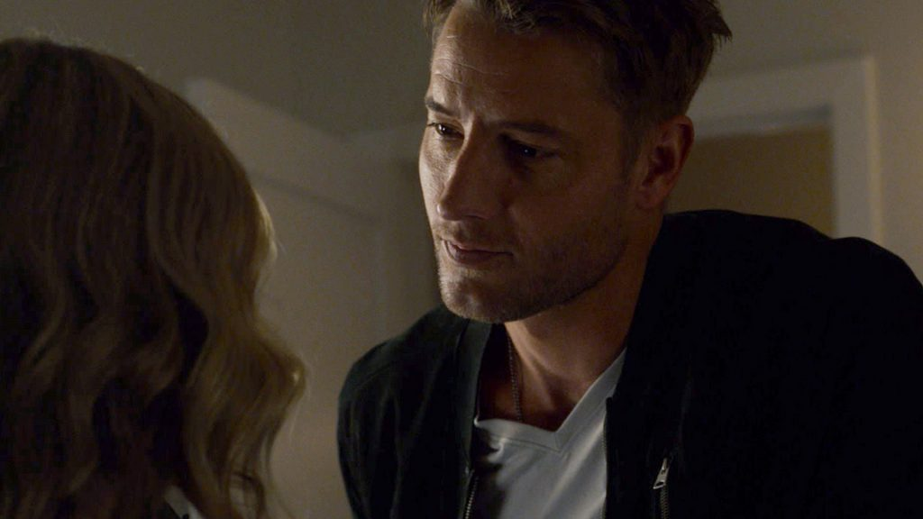 Justin Hartley as Kevin Pearson looks at Caitlin Thompson as Madison Simmons in 'This Is Us' Season 5 Episode 14, 'The Music and the Mirror.'