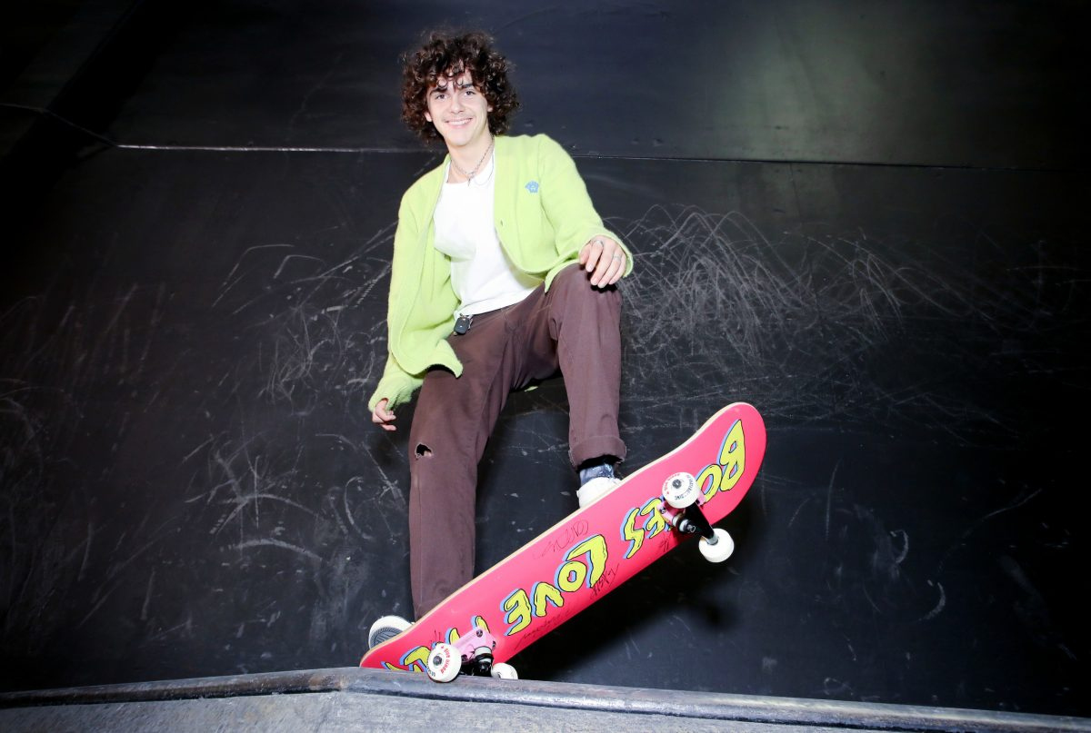 Jack Dylan Grazer, who voices Alfredo in Pixar's 'Luca,' posing on a red skateboard